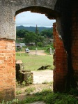 View of ancient Wat Phia Wat through building's remnants