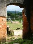 View of ancient Wat Phia Wat through building's remnants