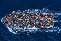 Asylum seekers from Africa traveling by boat on the Mediterranean, June 7, 2014. (Source: Massimo Sestini—Polaris).