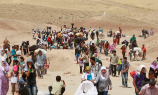 Syrian refugees crossed into Iraq at the Peshkhabour border point in August. (Source - WSJ)
