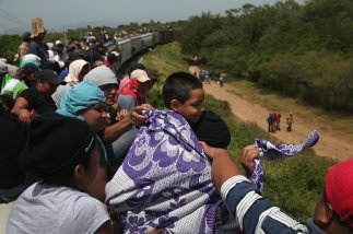 "Central Americans headed north by train (""El bestia""), hoping to make it to the United States. Source: NPR. John Moore/Getty Images."