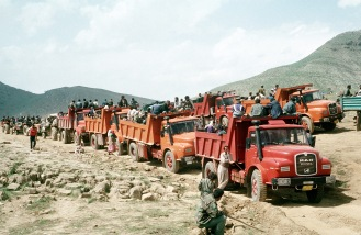 Kurdish refugees travel by truck, Turkey, 1991. Source: wikipedia.