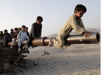 Children play on a damaged Soviet tank on the outskirts of Jalalabad east of Kabul, Afghanistan, Nov 13, 2012. ABC News.