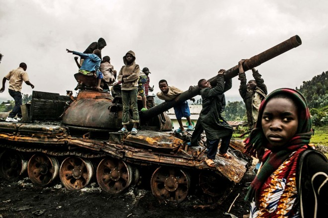 Congolese children play on a destroyed military tank in Kibumba, DRC. Prime Collective.