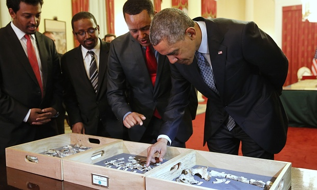 Pesident Obama touches the fossilized vertebra of Lucy, an early human ancestor in Ethiopia on Monday. Photograph: Jonathan Ernst/Reuters